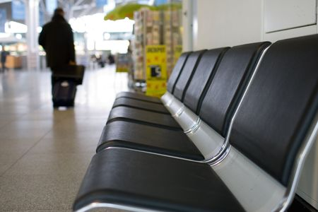 angled view: Angled view of a row of airport seats.