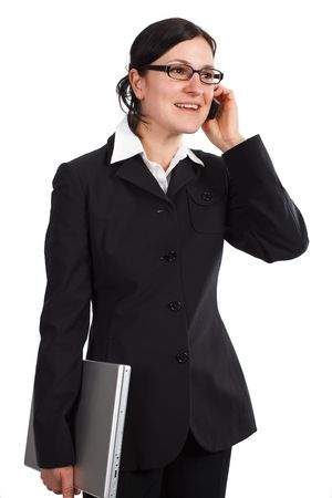 phoning: Businesswoman holding a cellphone and laptop while communication, isolated on white Stock Photo