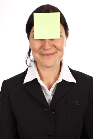 womans: Yellow sticker on smiling womans forehead Stock Photo