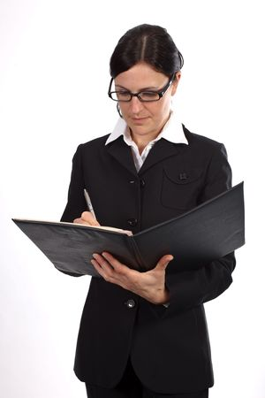 Businesswoman in black suite checks some documents Stock Photo