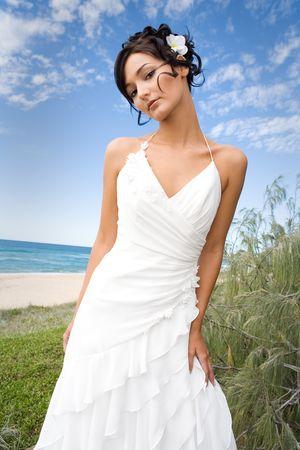 debutante: bride in wedding gown on beach