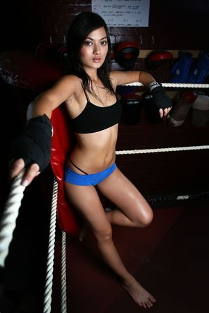 fit asian woman in boxing ring