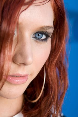 red head woman: portrait of red head woman with blue eyes