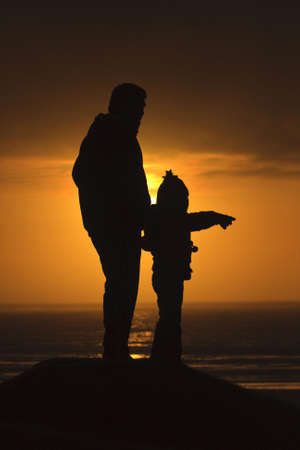 Young girl with man points into the distance