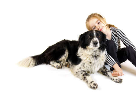 Young girl with border collie dog photo