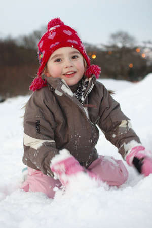 Young girl plays in the snow photo