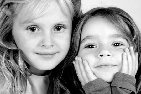 2 young happy girls pose