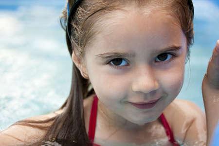 Young girl enjoys a swim photo