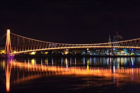 Pedestrian bridge in Osijek city Croatia Hrvatska in night with lights Stock Photo