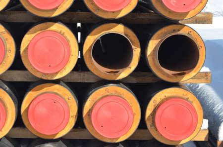 Construction Materials. Industrial pipes under snow Reklamní fotografie