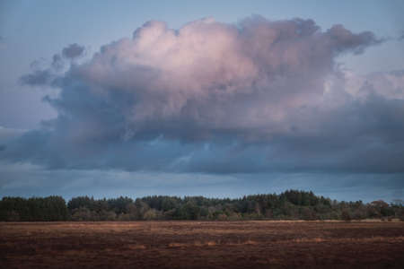 Large formidable cloud over the countryside at sunset. West Lothian, Scotland