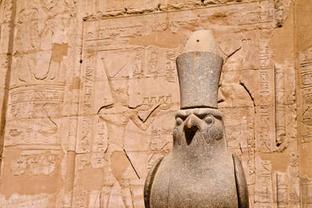 incarnation: Ancient stone statue in Egyptian temple, incarnation of Pharaoh