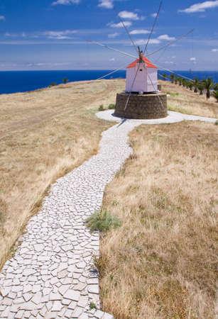 santo: Old small windmill on the Portuguese island of Porto Santo, stony footpath
