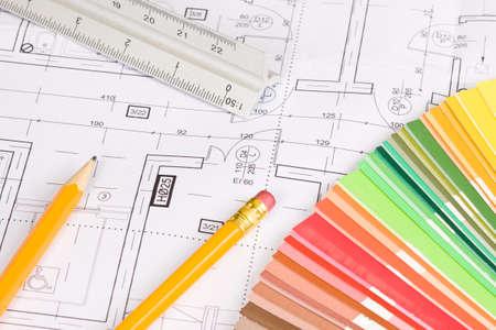 Pencils, scale ruler and colors palette on architectural project background Imagens