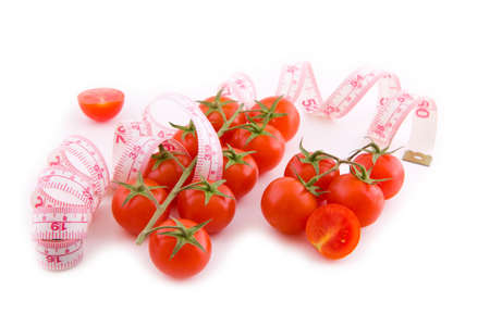 Small bunch of tomatoes with measure fitness tape on white Stock Photo - 17180429