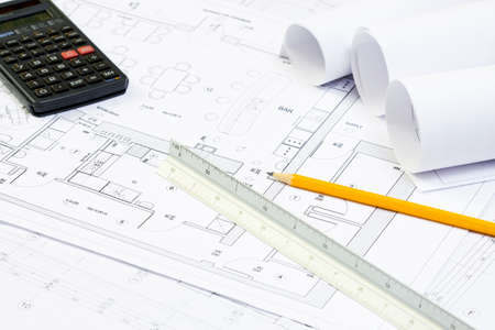 Blueprint of architecture, calculator, pencil and scale ruller