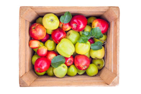 Fresh apples in a wooden box isolated on white background