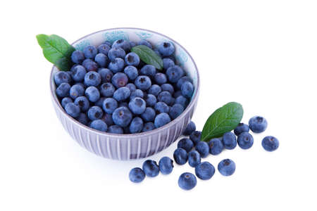 Blueberries in a bowl, fruits isolated on white background Imagens