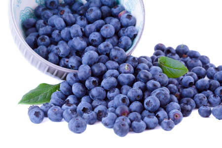 Fresh blueberries in a bowl, fruits isolated on white