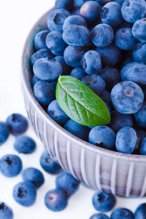 Fresh blueberries in a bowl, fruits on white background