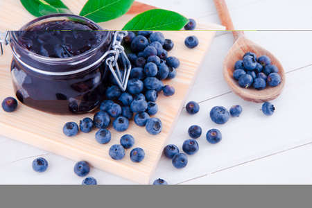 Blueberry fruits jam in the kitchen on the white table Imagens