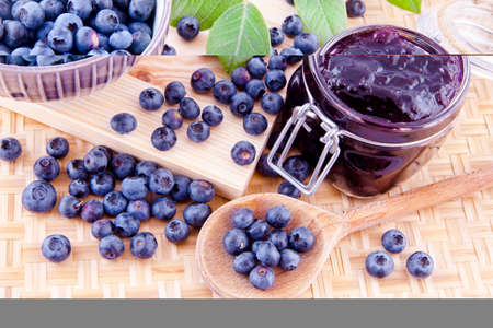 Blueberry jam and fresh fruits on the kitchen table Imagens