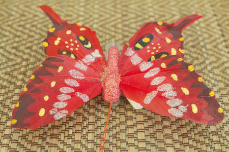impregnated: Butterfly with a tendril is made of paper and impregnated with varnish Stock Photo