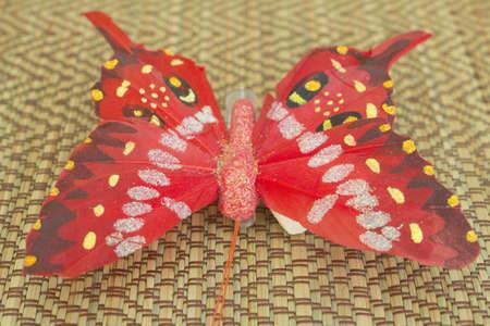 impregnated: Farfalla con un viticcio � fatta di carta e impregnata di vernice