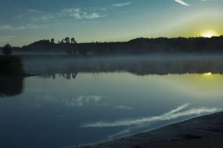 shroud: - Morning mist shrouded forest lake white shroud. Stock Photo