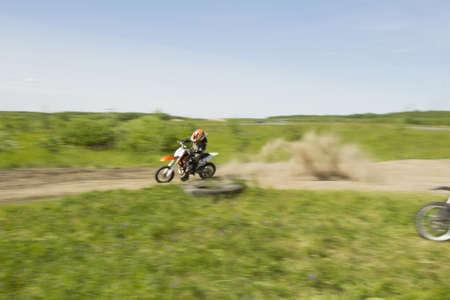Young athletes train on motodrome sports bikes. photo