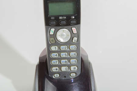 cordless phone: Black cordless phone on a white background