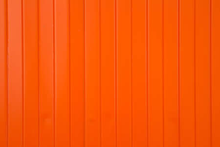 narrow: Background in the form of narrow and wide vertical orange stripes Stock Photo