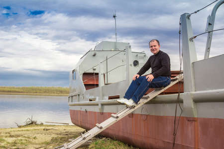 superstructure: Portrait of a man against the backdrop of a riverboat
