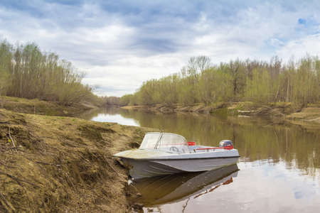 right bank: Motor boats moored on the right bank of the river Stock Photo