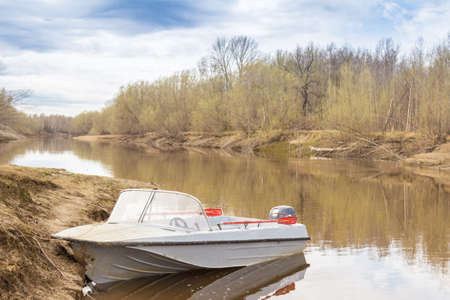 motor boats: Motor boats moored on the right bank of the river Stock Photo