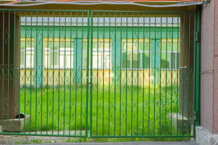 latticed: Fragment of a building of latticed gate Stock Photo