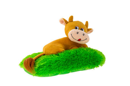 plush toy: Soft plush toy in the form of a hippopotamus lying on a green lawn