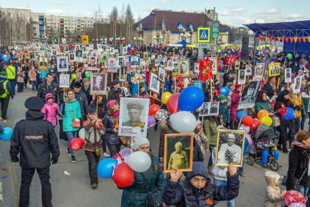 invaders: Demonstration of citizens of the city of Nefteyugansk ninth of May in the Victory Day over Nazi invaders. People came out on the main street of the city with photos of relatives who died during the Second World War, but living in their hearts.