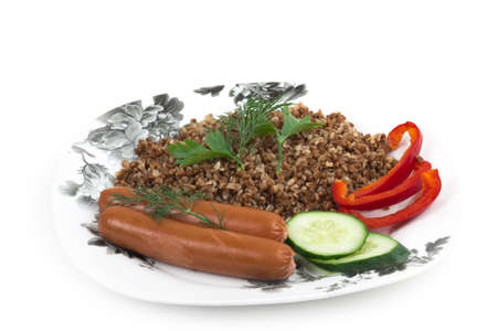 kasha: Sausages with buckwheat on the plate on a white background