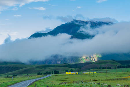 Farm at the foot of the Altai Mountains