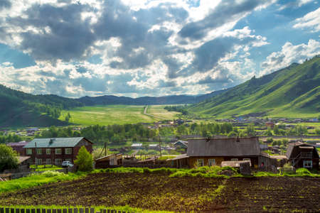 A small village in a mountain valley at the foot of the Altai Mountains