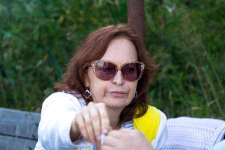 Portrait of a woman in glasses on the nature Stock Photo