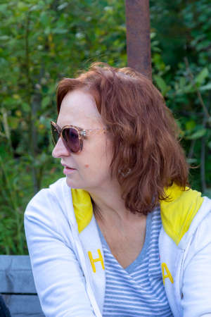 Portrait of a woman in glasses on the nature Stock Photo - 83332314