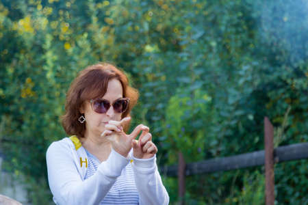 Portrait of a woman in glasses on the nature Stock Photo - 83332317