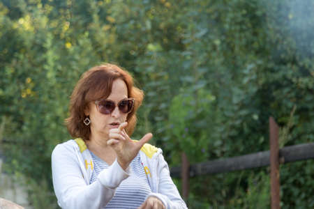 Portrait of a woman in glasses on the nature Stock Photo - 83332315