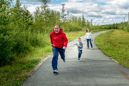 Dad, mom and son compete in the race