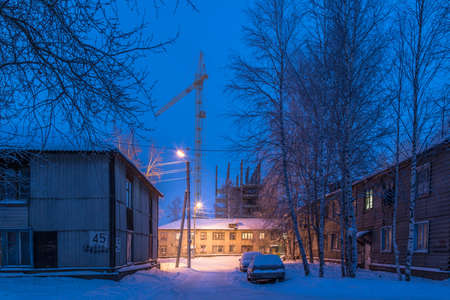 On a winter night in December in the citys slums, where there are lighted lampposts