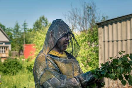 Portrait of a man in a mosquito net on a billet billet Stok Fotoğraf - 105073918