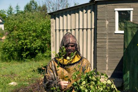 Portrait of a man in a mosquito net on a billet billet Stok Fotoğraf - 105073919
