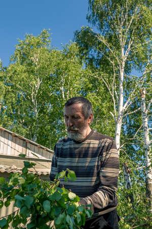 Portrait of a man in a mosquito net on a billet billet Stok Fotoğraf - 105171740